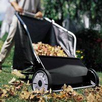 picking up leaves with a lawn sweeper